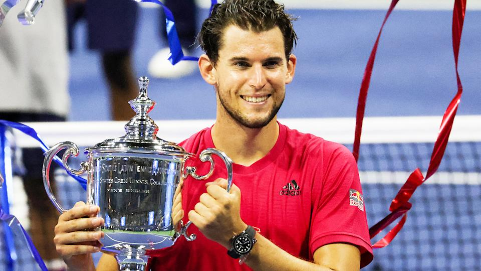 Dominic Thiem celebrates with the championship trophy after winning in a tie-breaker during his Men's Singles final match at the US Open.