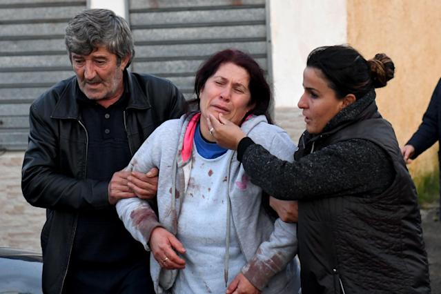 Relatives of people living at a collapsed building in Thumane, about 20 miles northwest of the capital Tirana, after an earthquake hit Albania on Nov. 26. (Photo: Gent Shkullaku/AFP via Getty Images)