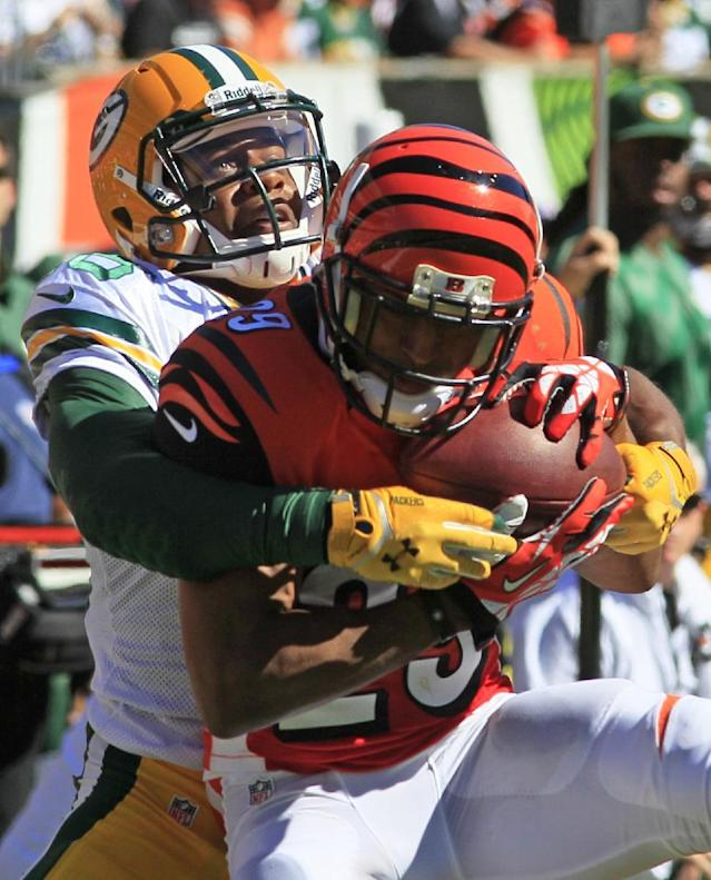 Cincinnati Bengals cornerback Leon Hall (29) intercepts a pass intended for Green Bay Packers wide receiver Randall Cobb in the second half of an NFL football game, Sunday, Sept. 22, 2013, in Cincinnati. (AP Photo/Tom Uhlman)