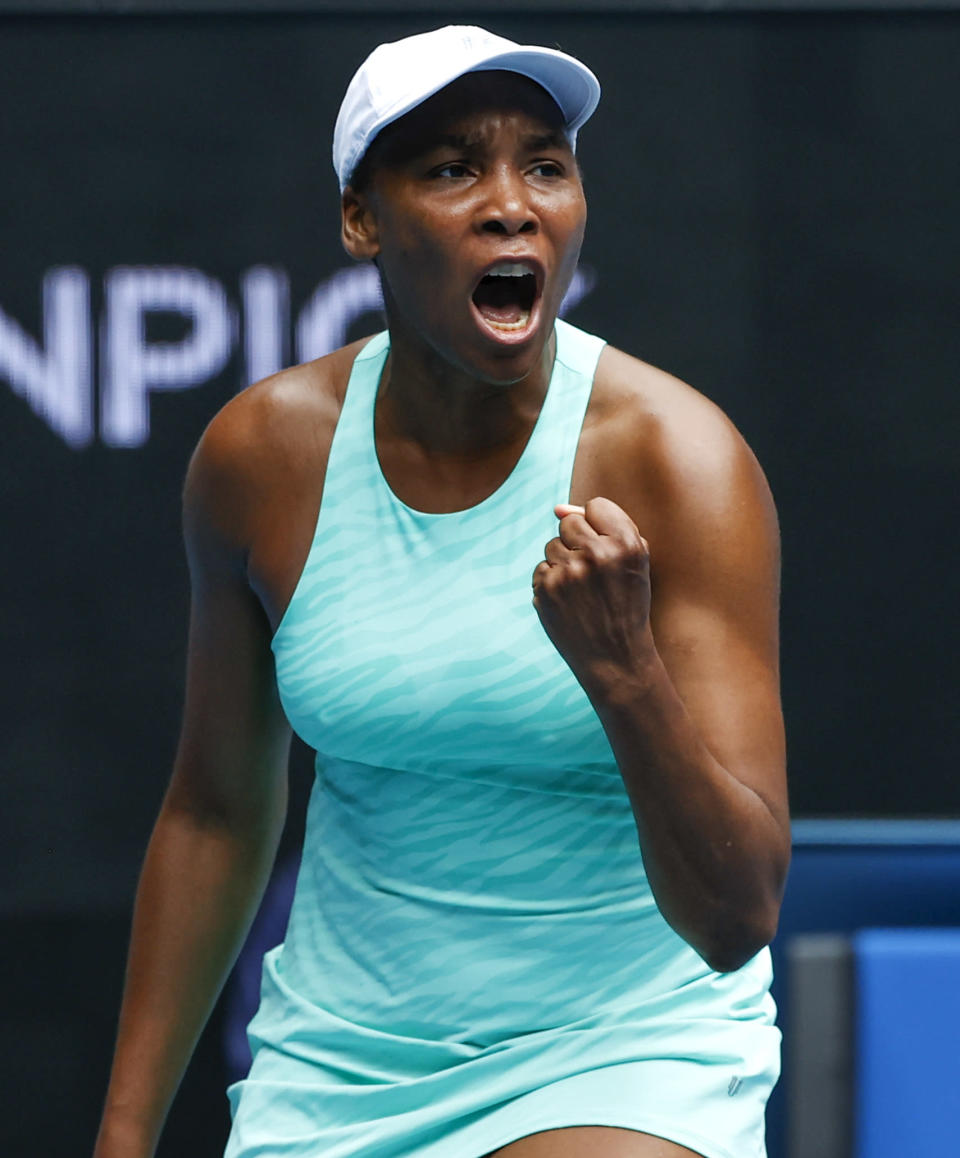 United States' Venus Williams celebrates after winning a point against Belgium's Kirsten Flipkens during their first round match at the Australian Open tennis championship in Melbourne, Australia, Monday, Feb. 8, 2021.(AP Photo/Rick Rycroft)