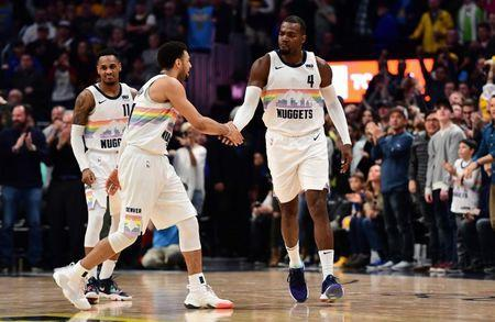 Mar 16, 2019; Denver, CO, USA; Denver Nuggets forward Paul Millsap (4) celebrates the go ahead points with guard Jamal Murray (27) in fourth quarter against the Indiana Pacers at the Pepsi Center. Mandatory Credit: Ron Chenoy-USA TODAY Sports
