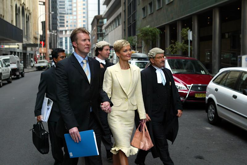 Former Channel 10 newsreader Jessica Rowe, arrives with her husband Peter Overton and legal representatives, at the Supreme Court, over a contractual dispute with Channel Ten. Rowe has been signed as the new host of the Today show on Channel Nine, 28 December 2005.