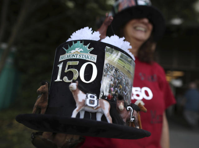 A horse racing fan holds a hat dressed up specially for the 150th running of the Belmont Stakes horse race in which Justify will attempt to become the 13th Triple Crown winner, Saturday, June 9, 2018, in Elmont, N.Y. (AP Photo/Mary Altaffer)