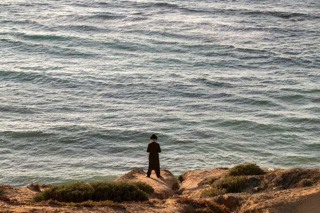 "<p>An ultra-Orthodox Jewish man prays along the Mediterranean Sea in the Israeli city of Herzliya, near Tel Aviv, while performing the ""Tashlich"" ritual on Sept. 28, 2017, during which ""sins are cast into the water to the fish"". The ""Tashlich"" ritual is performed before the Day of Atonement, or Yom Kippur, the most important day in the Jewish calendar, which in 2017 starts at sunset on Sept. 29. (Photo: Jack Guez/AFP/Getty Images) </p>"