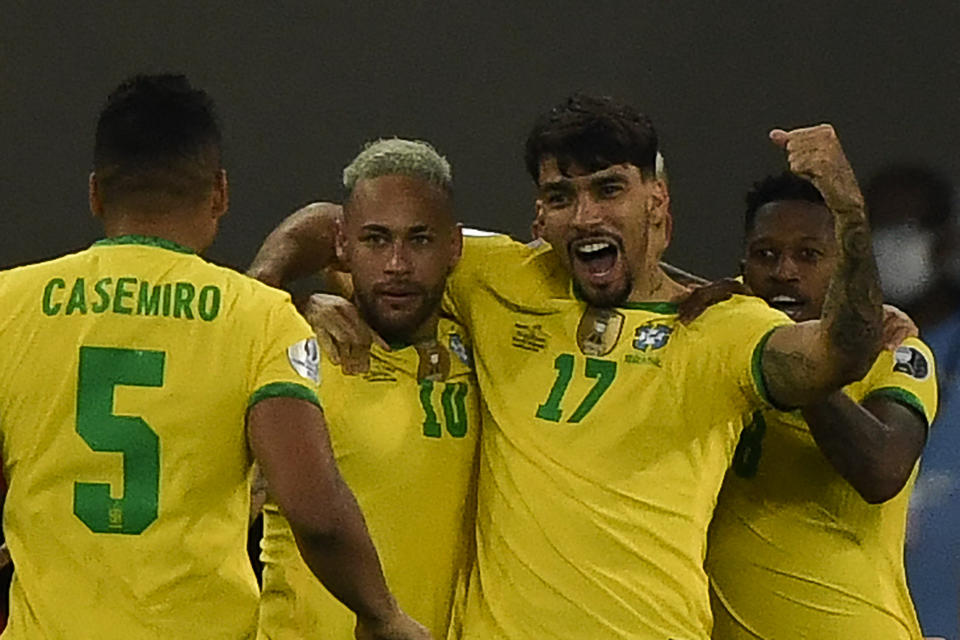 Brazil's Lucas Paqueta (2nd R) celebrates with teammates after scoring against Chile during their Conmebol 2021 Copa America football tournament quarter-final at the Nilton Santos Stadium in Rio de Janeiro, Brazil, on July 2, 2021. (Photo by MAURO PIMENTEL / AFP) (Photo by MAURO PIMENTEL/AFP via Getty Images)