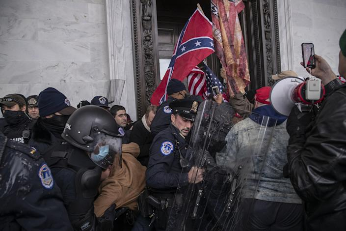 Demonstrators clash with U.S. Capitol police officers while trying to enter the Capitol building during a protest outside of in Washington, D.C. on Wednesday. (Victor J. Blue/Bloomberg via Getty Images)