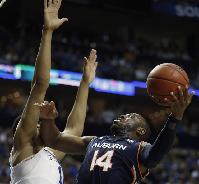 Auburn guard Antoine Mason (14) shoots against Kentucky forward Karl-Anthony Towns (12) during the first half of an NCAA college basketball game in the semifinal round of the Southeastern Conference tournament, Saturday, March 14, 2015, in Nashville, Tenn. (AP Photo/Steve Helber)