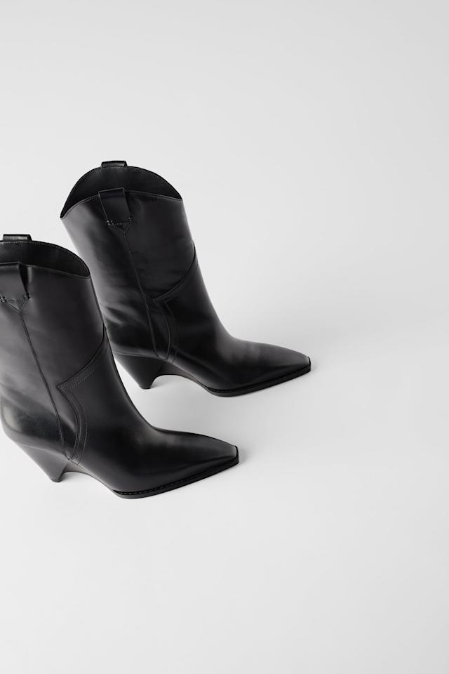 "<p>The Western boot trend is far from over. If you still have yet to buy into it, start with the <a href=""https://www.popsugar.com/buy/Zara-Heeled-Leather-Wedge-Cowboy-Boots-491003?p_name=Zara%20Heeled%20Leather%20Wedge%20Cowboy%20Boots&retailer=zara.com&pid=491003&price=199&evar1=fab%3Aus&evar9=46619861&evar98=https%3A%2F%2Fwww.popsugar.com%2Ffashion%2Fphoto-gallery%2F46619861%2Fimage%2F46619862%2FZara-Cowboy-Boots&list1=shopping%2Cfall%20fashion%2Cfall%2Czara%2Ceditors%20pick&prop13=mobile&pdata=1"" rel=""nofollow"" data-shoppable-link=""1"" target=""_blank"" class=""ga-track"" data-ga-category=""Related"" data-ga-label=""https://www.zara.com/us/en/heeled-leather-wedge-cowboy-boots-p15017001.html?v1=15329818&amp;v2=1281628"" data-ga-action=""In-Line Links"">Zara Heeled Leather Wedge Cowboy Boots</a> ($199).</p>"