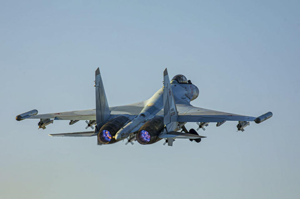 In this photo released by Russian Defense Ministry Press Service on Friday, June 25, 2021, a Su-35 fighter jet of the Russian air force takes off from the Hemeimeem air base in Syria. The Russian military on Friday launched sweeping maneuvers in the Mediterranean Sea featuring warplanes capable of carrying hypersonic missiles, a show of force amid a surge in tensions following an incident with a British destroyer in the Black Sea. (Russian Defense Ministry Press Service via AP)