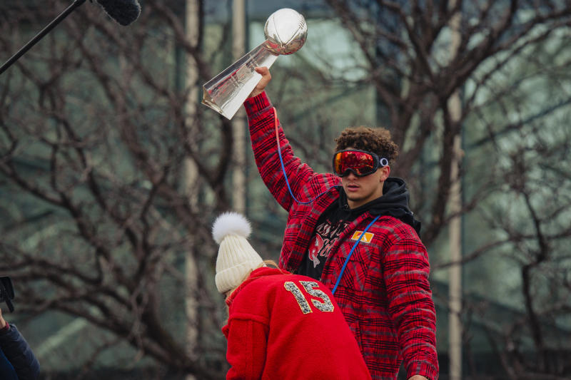 KANSAS CITY, MO - FEBRUARY 05: Patrick Mahomes #15 of the Kansas City Chiefs hoists the Vince Lombardi Trophy during the Kansas City Chiefs Victory Parade on February 5, 2020 in Kansas City, Missouri. (Photo by Kyle Rivas/Getty Images)