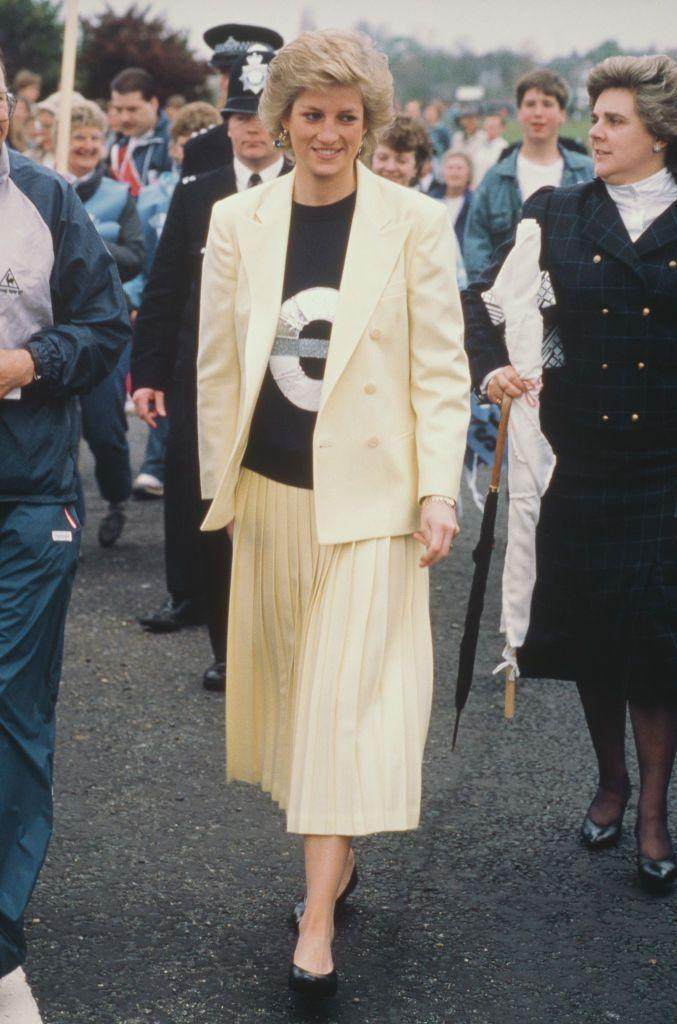 <p>This is proof that an oversized blazer will never go out of style. Diana wore this cream number over a sweater with the London Underground symbol on it while attending the London Marathon in April 1988.<br></p>