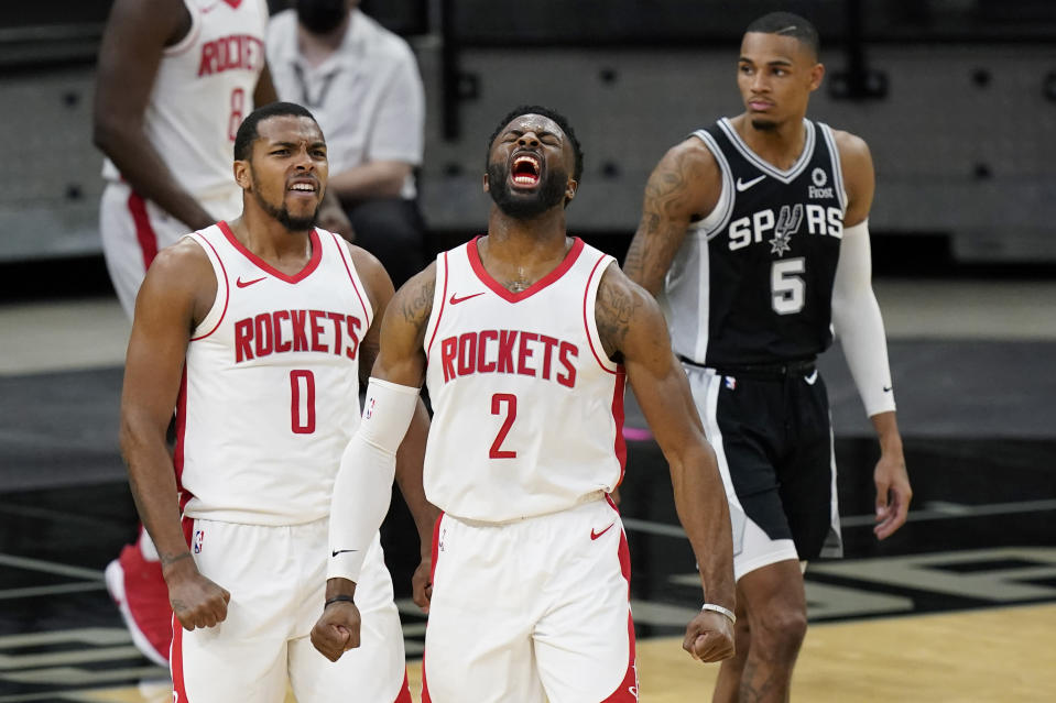 Houston Rockets guard Sterling Brown (0) and forward David Nwaba (2) celebrate their win over the San Antonio Spurs in an NBA basketball game in San Antonio, Thursday, Jan. 14, 2021. (AP Photo/Eric Gay)