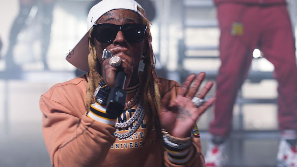 In this screengrab released on October 27, (L-R) Lil Wayne and 2 Chainz perform for the BET Hip Hop Awards 2020.