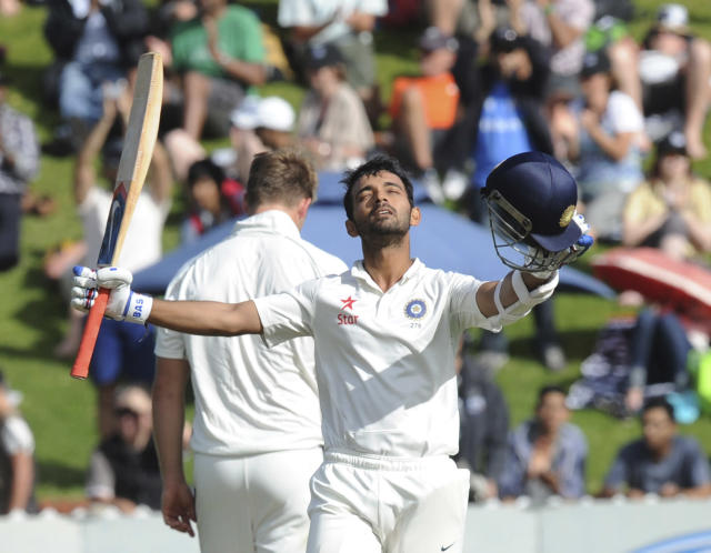 India's Ajinkya Rahane celebrates his first test century against New Zealand on the second day of the second cricket test in Wellington, New Zealand, Saturday, Feb. 15, 2014. (AP Photo/SNPA, Ross Setford) NEW ZEALAND OUT