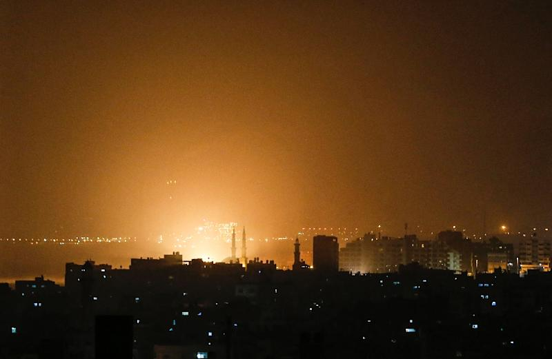 The sky above the Gaza City glows orange during an Israeli air strike late on March 14 (AFP Photo/MAHMUD HAMS)
