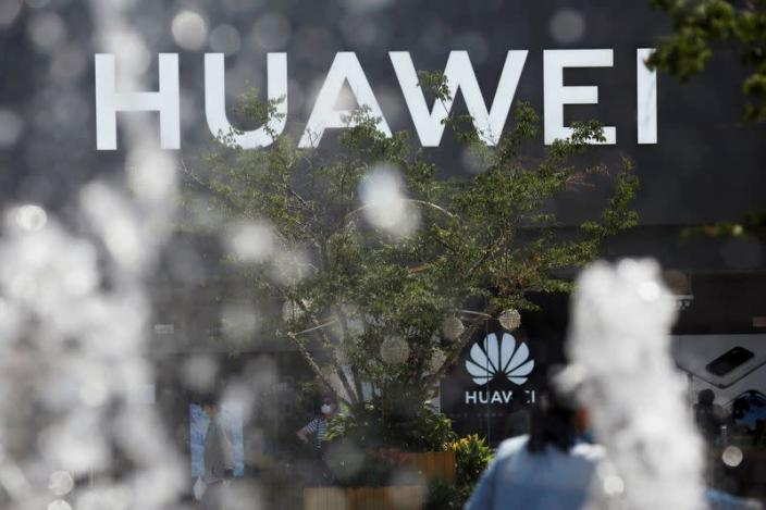 FILE PHOTO: Huawei sign is seen on its store at a shopping complex in Beijing