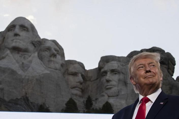 "President Trump smiles in front of Mt. Rushmore in South Dakota on July 3. <span class=""copyright"">(Associated Press)</span>"