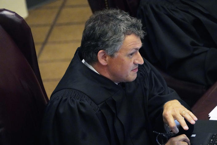 Mississippi Supreme Court Associate Justice Josiah Dennis Coleman questions attorneys presenting arguments over a lawsuit that challenges the state's initiative process and seeks to overturn a medical marijuana initiative that voters approved in November 2020, Wednesday, April 14, 2021, in Jackson, Miss. (AP Photo/Rogelio V. Solis)