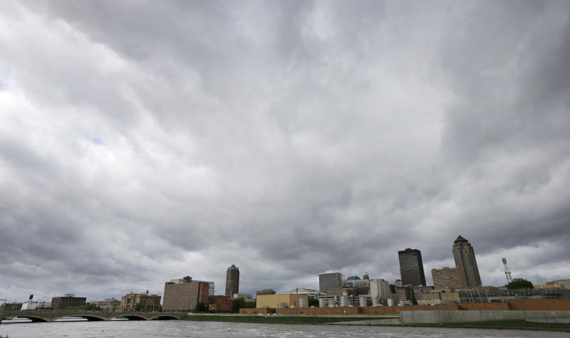 Storm clouds move over the downtown skyline, Thursday, May 30, 2013, in Des Moines, Iowa. Heavy rains expected Thursday night and Friday morning could lead to more flooding in the state. (AP Photo/Charlie Neibergall)