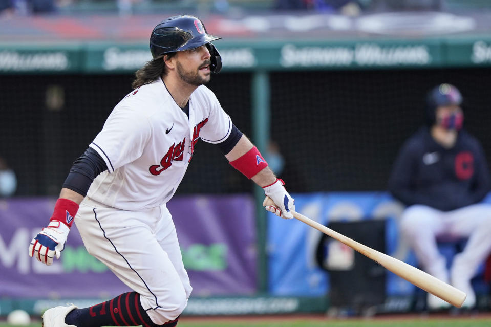 Cleveland Indians' Austin Hedges watches his RBI single during the fourth inning of the team's baseball game against the Cincinnati Reds, Saturday, May 8, 2021, in Cleveland. (AP Photo/Tony Dejak)