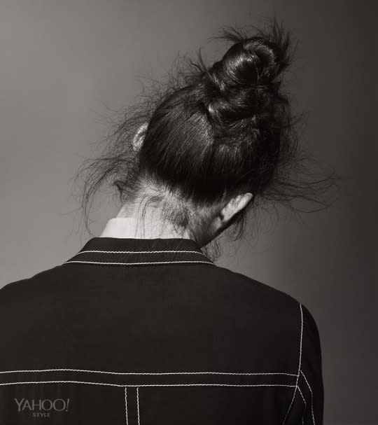 """<p>It's rare that a men's hairstyle sparks a trend/movement/lifestyle, and yet that is exactly what happened with the man-bun. Keep things cool and casual, with a crown of fly-aways surrounding you, like a halo. <br /><br />Prada Poplin Shirt, $550, Available at Select Prada Boutiques, <a href=""""http://www.prada.com%20"""">prada.com</a></p>"""