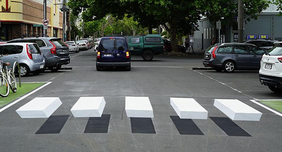 The floating 3D crossing was installed outside an IGA in Fitzroy North to try and alert drivers into being aware of their surroundings.