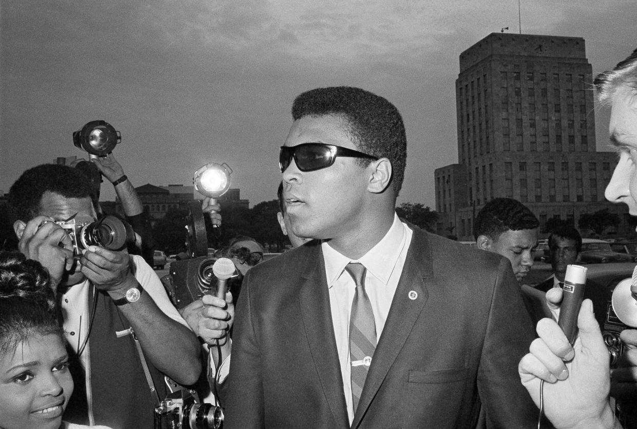 Muhammad Ali in 1967 at the Federal Building in Houston, where a federal judge told him to refile his plea to avoid the draft after his scheduled induction. (Photo: Fred Kaufman/AP)