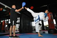 Afghan-born refugee Asif Sultani pratises his karate kiciks as he trains in a bid to win a place on the refugee team at the Tokyo Olympics in July