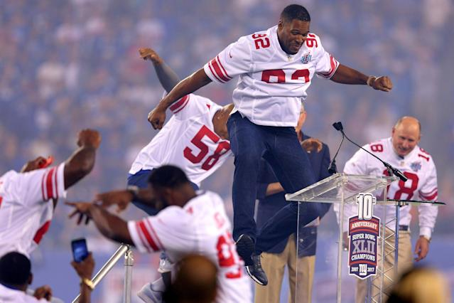 Sep 18, 2017; East Rutherford, NJ, USA; Former New York Giants player Michael Strahan celebrates during a halftime ceremony honoring the 2007 Super Bowl champion Giants during a game against the Detroit Lions at MetLife Stadium. Mandatory Credit: Brad Penner-USA TODAY Sports TPX IMAGES OF THE DAY
