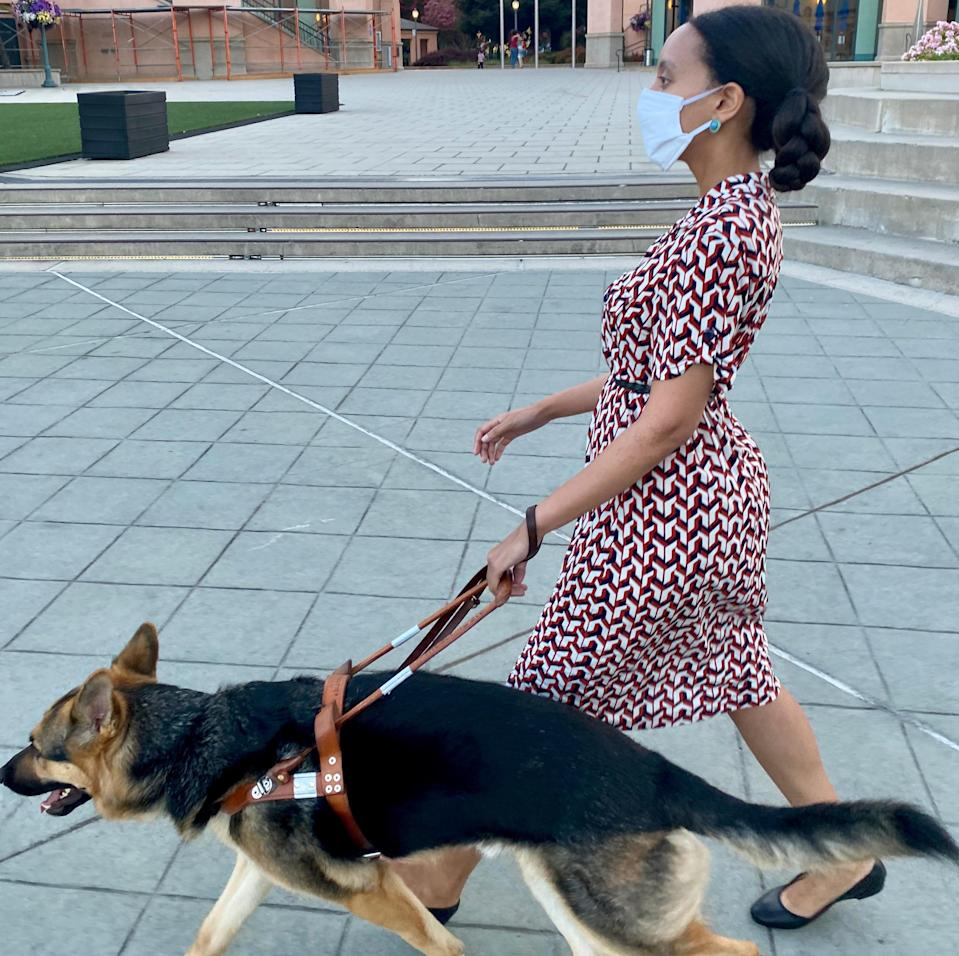 Haben Girma and her guide dog Mylo walking on the sidewalks of downtown Mountain View, CA.