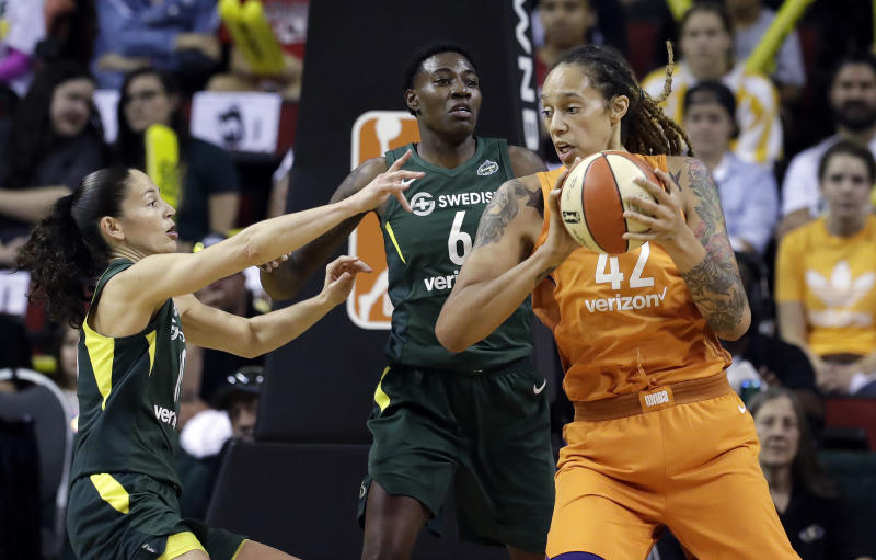 Phoenix Mercury's Brittney Griner (42) is doubled-teamed by Seattle Storm's Sue Bird, left, and Natasha Howard (6) in the first half in a WNBA basketball playoff semifinal Tuesday, Aug. 28, 2018, in Seattle. (AP Photo/Elaine Thompson)