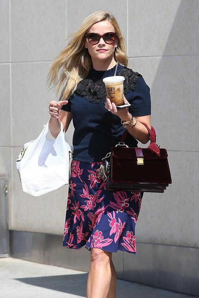 <p>Reese may have worn berries on her skirt, but it was a cup of coffee and lunch that she left Panera Bread with. (Photo: AKM-GSI) </p>