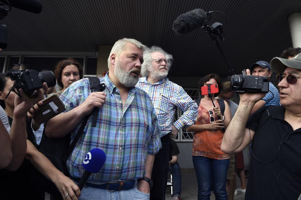 FILE - In this June 8, 2019 file photo, Co-founder and former head of Novaya Gazeta, Dmitry Muratov, foreground, and the Ekho Moskvy (Echo of Moscow) radio station's editor-in-chief, Alexei Venediktov speak to supporters of Ivan Golunov, a journalist who worked for the independent website Meduza, at a court building in Moscow, Russia. As a new Nobel Peace Prize laureate, Russian newspaper editor Dmitry Muratov has downplayed the buzz around his name. The award isn't for him, he says, but for all of the staff at Novaya Gazeta, the independent Russian newspaper noted for investigations of official corruption, human rights abuses and Kremlin criticism. (AP Photo/Dmitry Serebryakov)