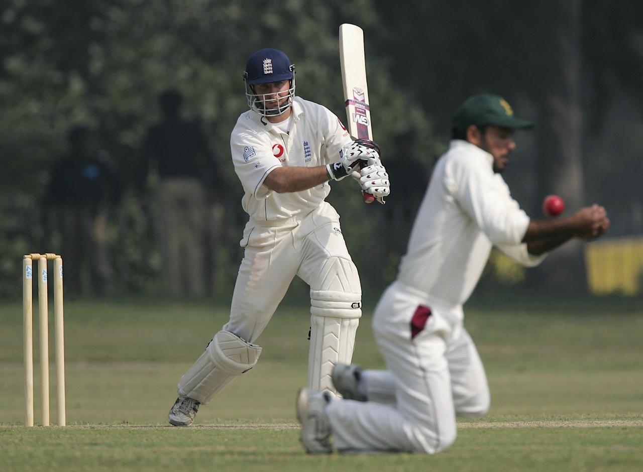 LAHORE, PAKISTAN - NOVEMBER 6: England captain Michael Vaughan is denied runs by a close in fielder during the first day of the three day game against Pakistan 'A'  at Bagh-E-Jinnah on November 6, 2005 in Lahore, Pakistan. (Photo by Stu Forster/Getty Images)