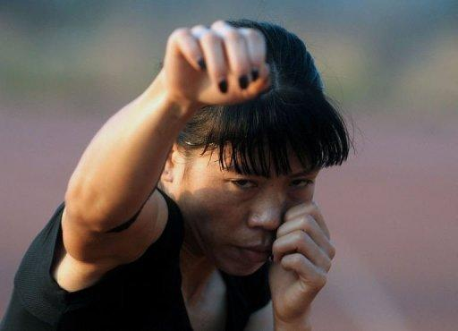 "Indian boxer MC Mary Kom during a training session in Pune on April 20. From her beginnings as a poor farmers' daughter in a troubled corner of India, ""Magnificent Mary"" has fought her way up to become five-times world boxing champion"