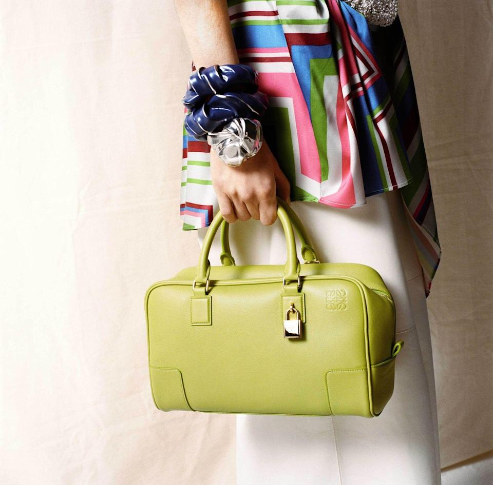"""<p><strong>Who:</strong> Loewe</p><p><strong>What:</strong> Reintroduction of the Amazona bag</p><p><strong>Where: </strong>Available worldwide in Loewe stores and on <a href=""""https://www.loewe.com/usa/en/home"""" rel=""""nofollow noopener"""" target=""""_blank"""" data-ylk=""""slk:loewe.com"""" class=""""link rapid-noclick-resp"""">loewe.com</a></p><p><strong>Why:</strong> Loewe is celebrating its 175th anniversary, and in honor of the occasion, the Spanish leather goods house is relaunching the iconic Amazona bag. First introduced in the '70s, the Amazona takes its name from female characters in Greek mythology and was inspired by women joining the workforce and fighting for gender equality during that decade. The handbag comes in two sizes and two different textiles: Loewe's signature nappa leather and a new blended cotton emblazoned with Loewe's pattern logo. The leather comes in a variety of hues taken straight from the fall/winter 2021 runway, and deliver on the promise of easy, durable handbags that will fit enough to get you through the day and into the night. </p>"""