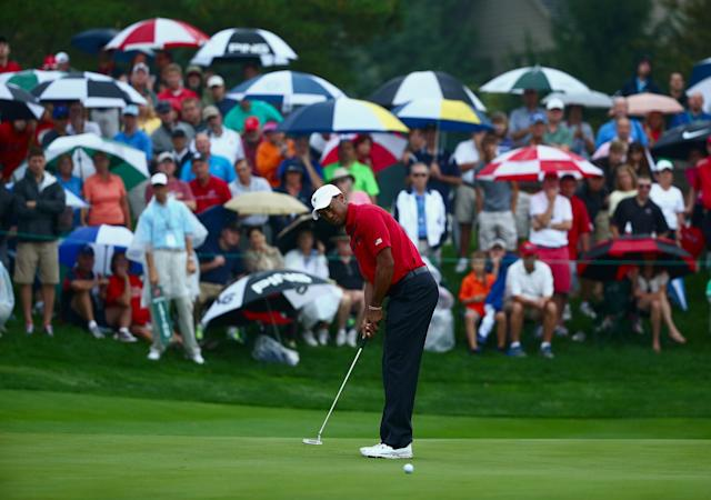 DUBLIN, OH - OCTOBER 05: Tiger Woods of the U.S. Team putts for eagle on the fifth green during the Day Three Four-ball Matches at the Muirfield Village Golf Club on October 5, 2013 in Dublin, Ohio. (Photo by Andy Lyons/Getty Images)
