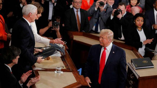 PHOTO: President Donald Trump turns after handing copies of his speech to House Speaker Nancy Pelosi, and Vice President Mike Pence as he delivers his State of the Union address to a joint session of Congress on Capitol Hill in Washington, Feb. 4, 2020. (J. Scott Applewhite/AP)