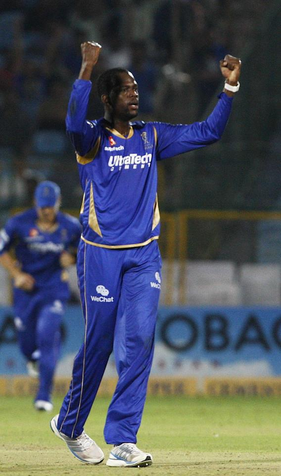 Rajasthan Royals' Kevon Cooper celebrate fall of wicket against Perth Scorchers during the CLT20 match at Sawai Mansingh Stadium, Jaipur on Sept. 29, 2013. (Photo: IANS)