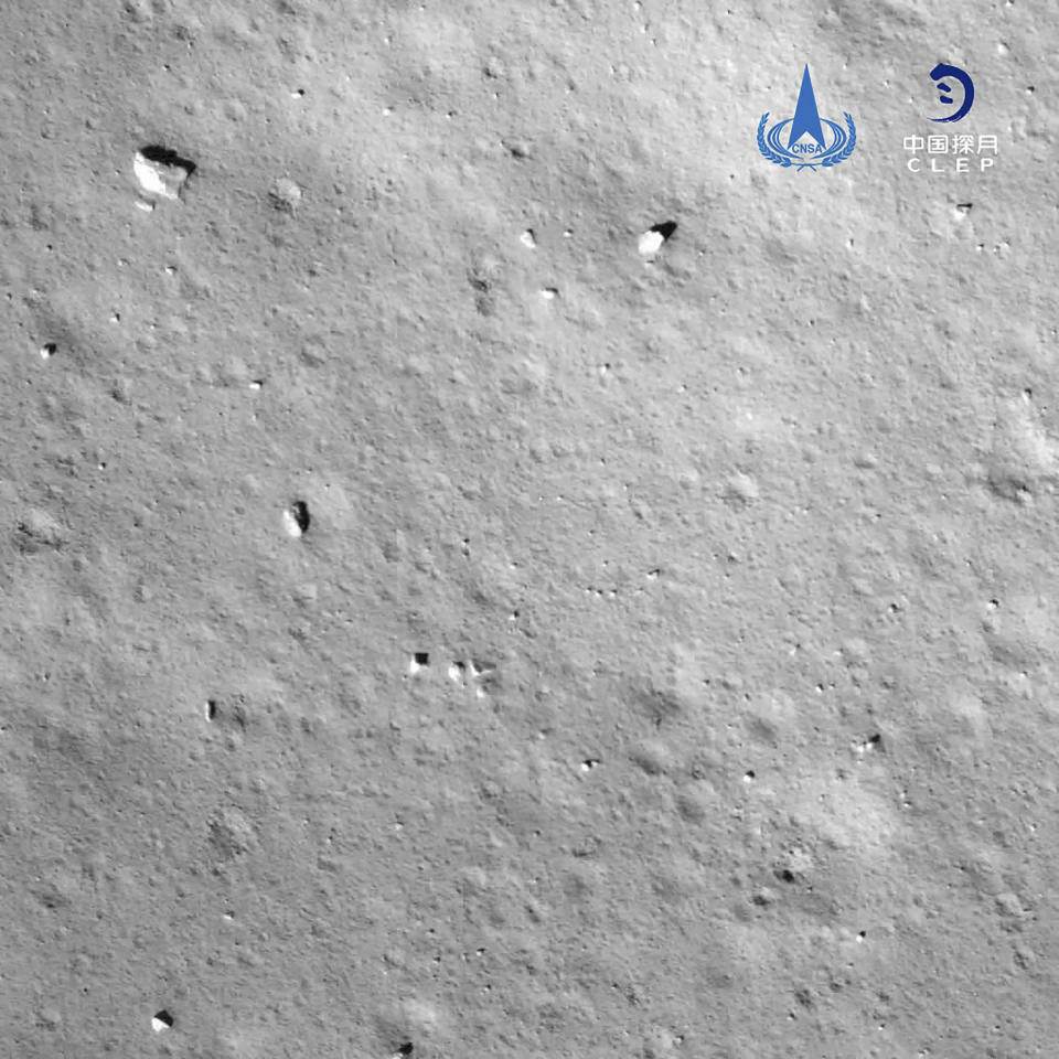 This image taken by camera aboard Chang'e-5 spacecraft provided by China National Space Administration shows a moon surface during its landing process Tuesday, Dec. 1, 2020. The Chinese spacecraft landed on the moon Tuesday to bring back lunar rocks to Earth for the first time since the 1970s, the government announced. (China National Space Administration via AP)