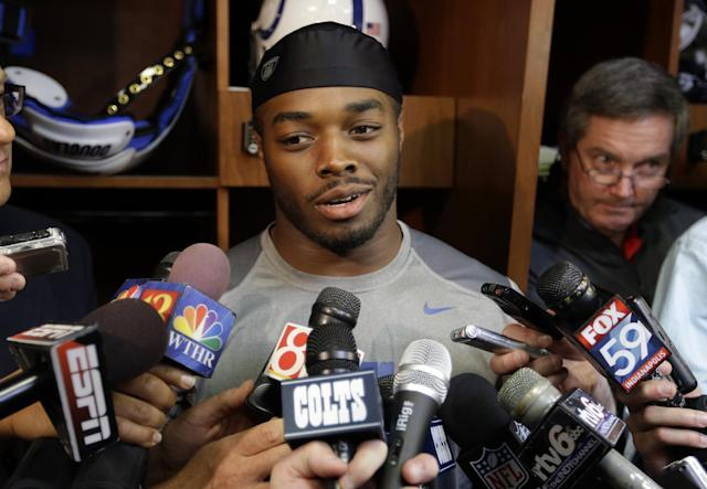 Indianapolis Colts running back Trent Richardson talks about joining the NFL football team after being traded by the Cleveland Browns as he meets with the media in the locker room in Indianapolis, Thursday, Sept. 19, 2013. (AP Photo/Michael Conroy)