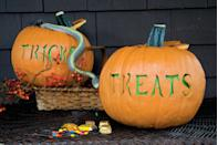 """<p>Grab a pair of pumpkins to carve out the words """"Tricks"""" and """"Treats"""" using a <a href=""""https://www.womansday.com/home/crafts-projects/a28638358/tricks-and-treats-pumpkin-stencil/"""" rel=""""nofollow noopener"""" target=""""_blank"""" data-ylk=""""slk:pumpkin stencil"""" class=""""link rapid-noclick-resp"""">pumpkin stencil</a>. Then, place neon green paper inside to really send the message home. </p><p><a href=""""https://www.womansday.com/home/crafts-projects/a28638433/tricks-and-treats-pumpkin/"""" rel=""""nofollow noopener"""" target=""""_blank"""" data-ylk=""""slk:Get the tutorial at Woman's Day »"""" class=""""link rapid-noclick-resp""""><em>Get the tutorial at Woman's Day »</em></a></p>"""