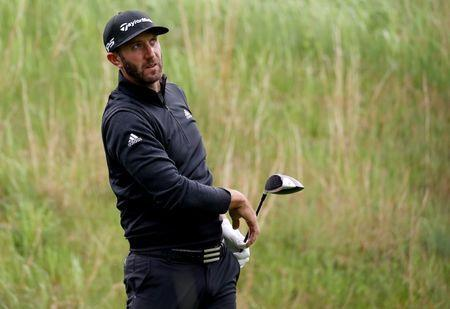 May 14, 2019; Farmingdale, NY, USA; Dustin Johnson looks over the third green during a practice round for the PGA Championship golf tournament at Bethpage State Park - Black Course. Mandatory Credit: Peter Casey-USA TODAY Sports