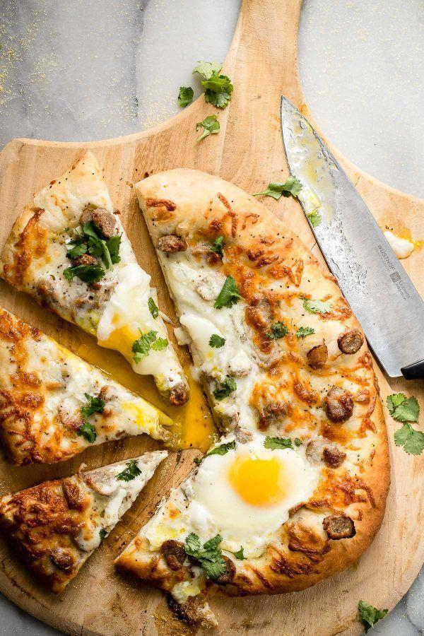 """<p>It's definitely a special day when you're eating pizza for breakfast! Make sure to sprinkle each slice with fresh cilantro. </p><p><strong>Get the recipe at <a href=""""https://foodnessgracious.com/sausage-and-egg-breakfast-pizza/"""" rel=""""nofollow noopener"""" target=""""_blank"""" data-ylk=""""slk:Foodness Gracious"""" class=""""link rapid-noclick-resp"""">Foodness Gracious</a>.</strong></p>"""
