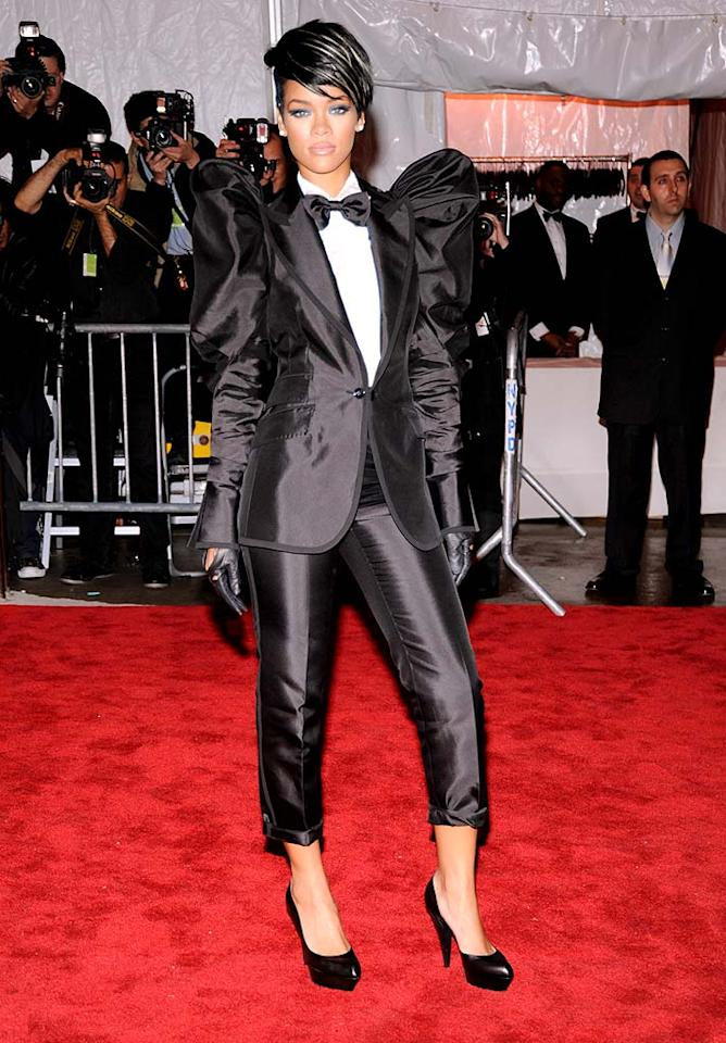 "Rihanna made a triumphant return to the red carpet at last night's Costume Institute Gala at NYC's Metropolitan Museum of Art following her recent tabloid trauma with Chris Brown. Unfortunately, her Dolce & Gabbana cropped pant suit was a complete disaster. Kevin Mazur/<a href=""http://www.wireimage.com"" target=""new"">WireImage.com</a> - May 1, 2009"