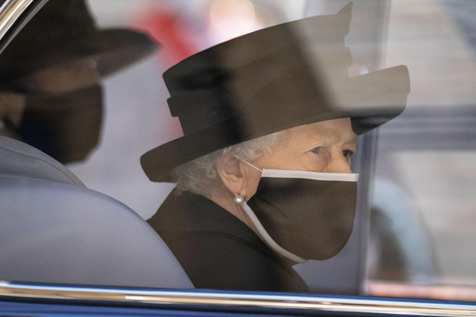 <p>The Queen was forced to sit alone during the socially distanced service at St George's Chapel </p> (PA Wire)