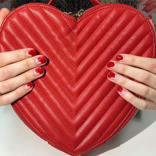 """<p>This manicure alludes to V-Day thanks to the glossy red paint and subtle heart design.</p><p><a href=""""https://www.instagram.com/p/BtZcDzFAr42/"""" rel=""""nofollow noopener"""" target=""""_blank"""" data-ylk=""""slk:See the original post on Instagram"""" class=""""link rapid-noclick-resp"""">See the original post on Instagram</a></p>"""