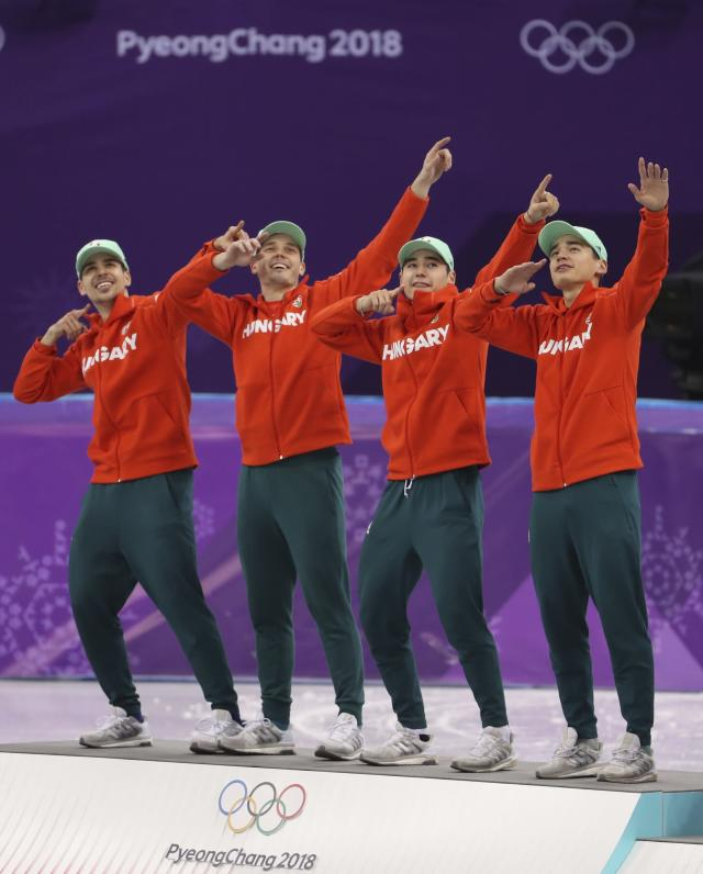 Short Track Speed Skating Events - Pyeongchang 2018 Winter Olympics - Men's 5000m Relay Final - Gangneung Ice Arena - Gangneung, South Korea - February 22, 2018 - Gold medallists Viktor Knoch, Csaba Burjan, Liu Shaoang and Sandor Liu Shaolin of Hungary pose in celebration on the podium. REUTERS/Lucy Nicholson