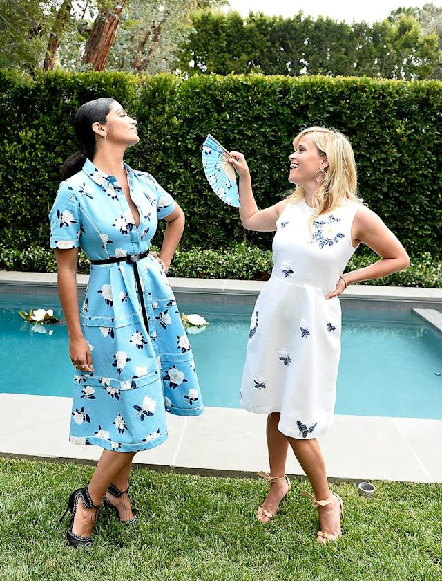 <p>Guests drank lemonade and sweet tea, nibbled on biscuits and fried chicken, listened to bluegrass music, and fanned themselves — or, in Witherspoon's case, their friends — with custom fans, at a Beverly Hills fete celebrating the capsule collection that Witherspoon's Draper James did for Net-a-Porter. (Photo: Stefanie Keenan/Getty Images for NET-A-PORTER) </p>