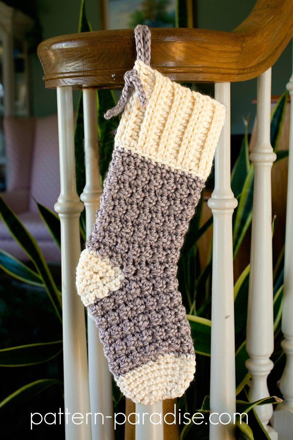 """<p>This simple, yet modern, stocking is the understated touch your mantel needs this Christmas.</p><p><strong>Get the tutorial at <a href=""""https://pattern-paradise.com/2017/12/04/free-crochet-pattern-cozy-cottage-christmas-stocking/"""" rel=""""nofollow noopener"""" target=""""_blank"""" data-ylk=""""slk:Pattern Paradise"""" class=""""link rapid-noclick-resp"""">Pattern Paradise</a>.</strong></p><p><strong><a class=""""link rapid-noclick-resp"""" href=""""https://www.amazon.com/Clover-3672-Amour-Crochet-sizes/dp/B00B2CCA6W/ref=sr_1_3?tag=syn-yahoo-20&ascsubtag=%5Bartid%7C10050.g.28872655%5Bsrc%7Cyahoo-us"""" rel=""""nofollow noopener"""" target=""""_blank"""" data-ylk=""""slk:SHOP CROCHET HOOKS"""">SHOP CROCHET HOOKS</a><br></strong></p>"""